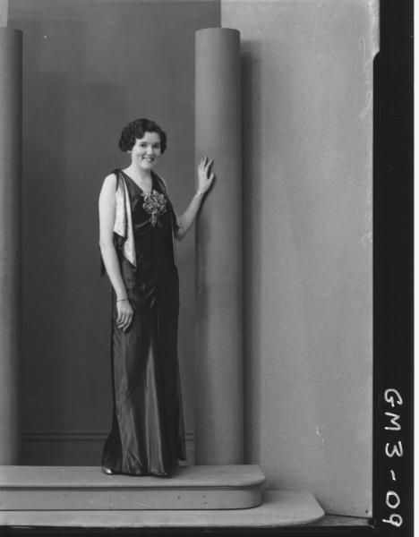 Portrait of a woman in evening dress, F/L, 'James'.