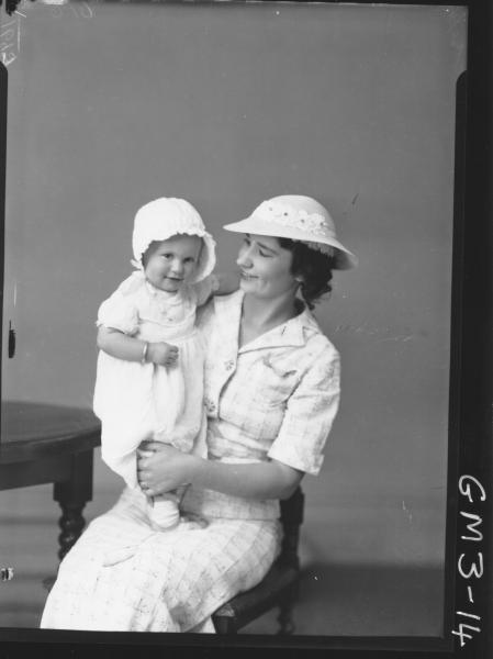 Portrait of woman in short sleeved suit and hat, and baby with bonnet, F/L, 'Joseph'.