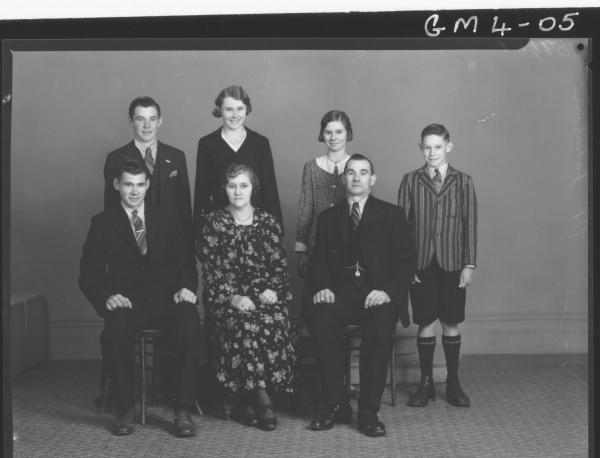 Portrait of family group man, woman and five children , F/L Johnson.