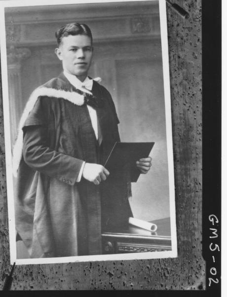 Board pinned copy of portrait of young man in graduation robes, Mrs Lucich.