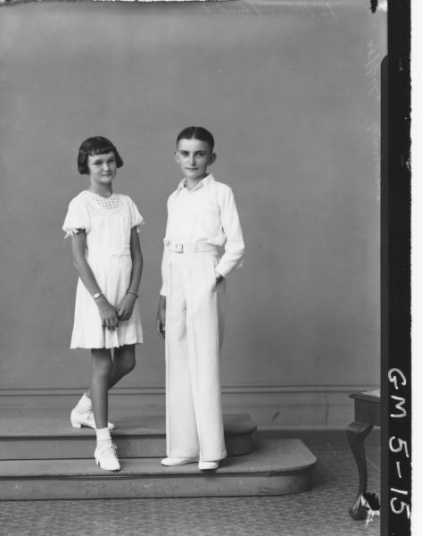 Portrait of young man and girl, F/L Griffin Keating.