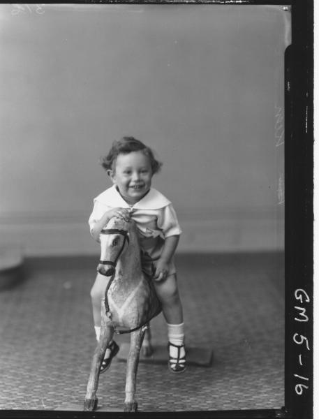 Portrait of young child on rocking horse, F/L Keen.