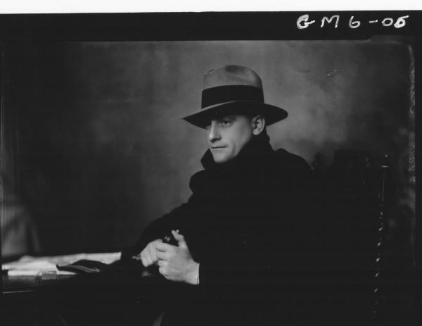 Portrait of man in overcoat and hat, H/S Kyle.