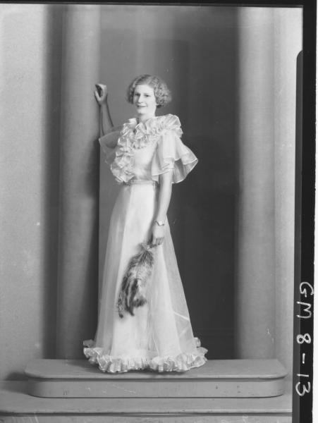 Poartrait of young woman in evening dress, F/L Kenning.