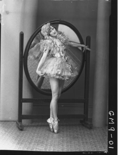 Portrait of woman dancer in costume, F/L Leaared.