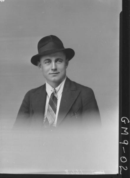 Portrait of man wearing hat, H/S Lewis.
