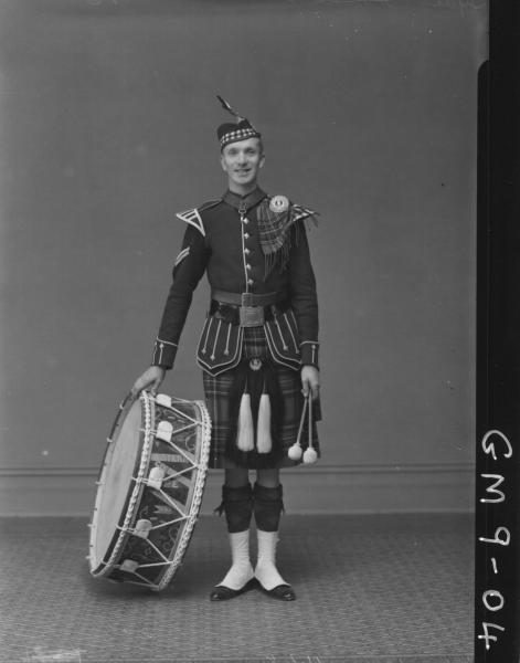 Portrait of man in full Scottish Pipe Band Kilt with Drum, F/L Lyal.