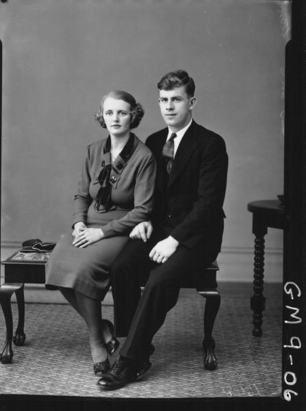 Portrait of woman and man, F/L Loan.