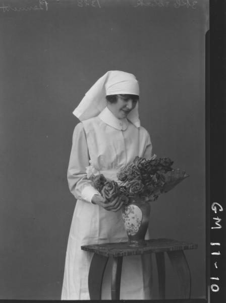 Portrait of young woman in nursing uniform,'Bennett'.