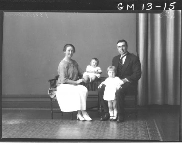 Portrait of a woman, man and two children, 'Dunne'