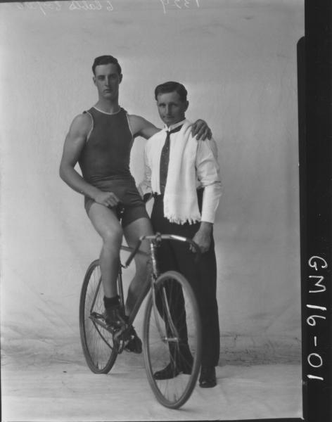 Portrait of young male bike rider, Oliver (Ted) Edward COOPER and trainer Charles Cooper, (two men not related)  Oliver Cooper was a Goldfields Champion and was deaf.  F/L.