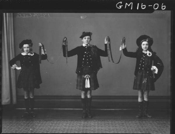 three young people in scottish costume F/L, 'Brown' and 'Mills'