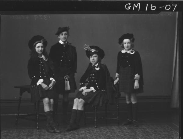 four young people in scottish costume F/L, 'Brown' and 'Mills'