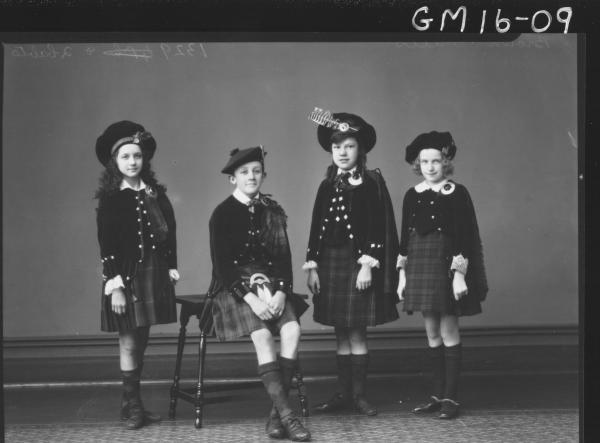 portrait of four young people in scottish national dress F/L'Brown' and 'Mills'