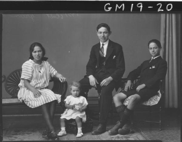 portrait of young woman, two young men and child, 'Green'