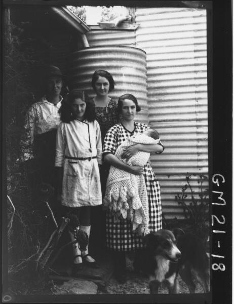 Poratrait of three women, one young girl, a baby and dog outside a house F/L, Jenkins, Gibson Soak.