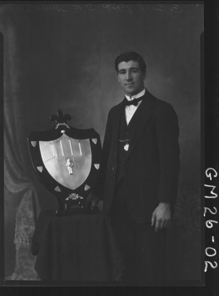portrait of young man holding sports shield F/L, Mills (Ray)