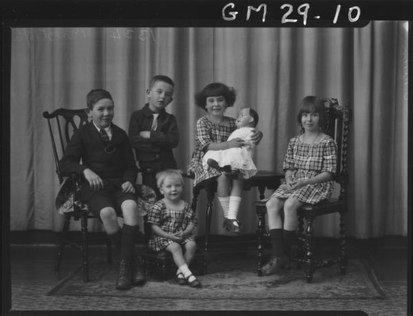 portrait of family, two boys and three girls, one holding large china doll, F/L O'Brien