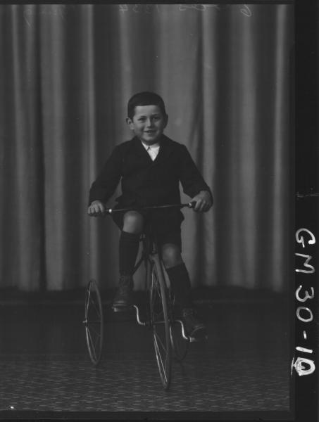 portrait of young boy riding tricycle, F/L Pysing