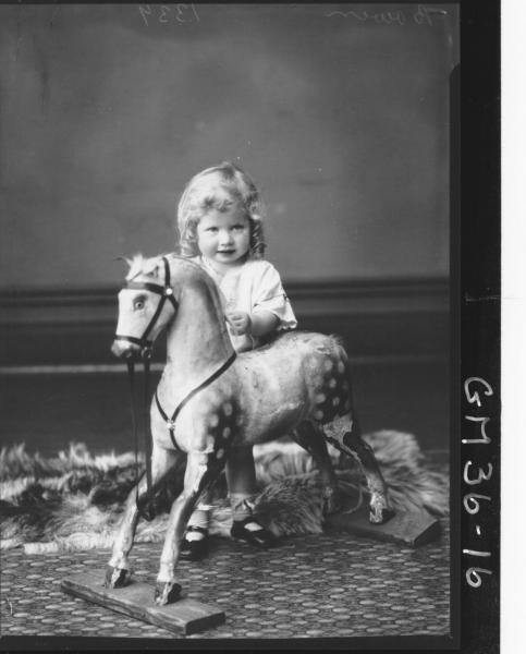 portrait of small girl on rocking horse, Bowen