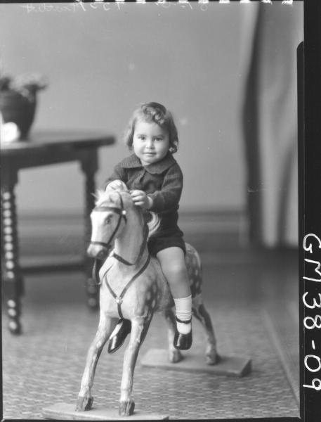portrait of child on rocking horse, F/L Bartlett