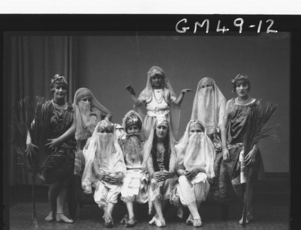 portrait of nine children in fancy dress, F/L Priest