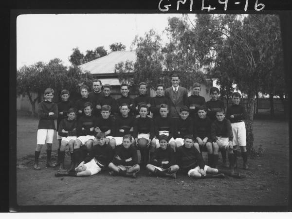 full football team plus Priest