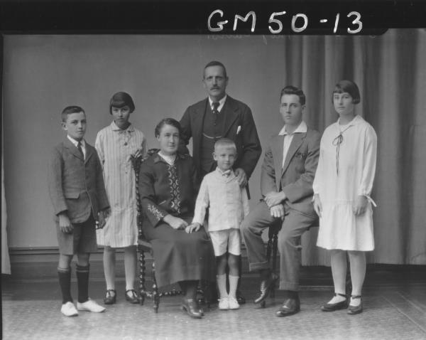 portrait of woman, man and five children, F/L Ford