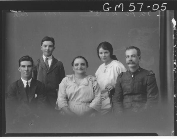 Portrait of woman, man in Salvation Army uniform and three children back