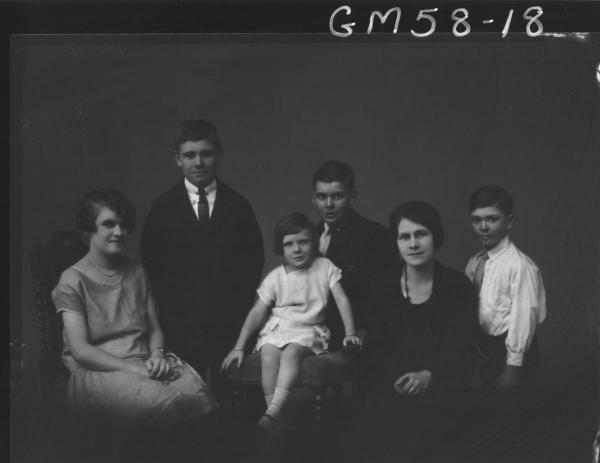 Portrait of two women and four children Badock