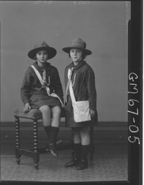 PORTRAIT OF TWO GIRLS IN GUIDE UNIFORMS