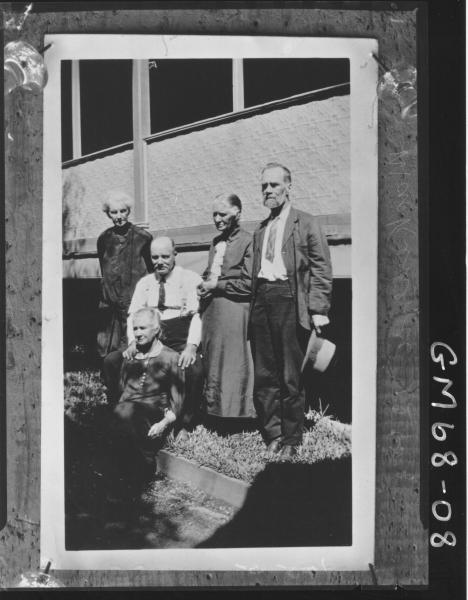 FIVE ELDERLY PEOPLE OUTSIDE HOUSE, MACKENZIE