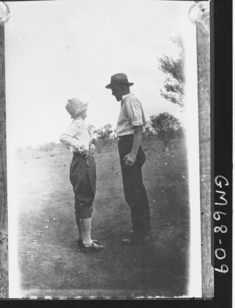 WOMAN AND MAN IN GARDEN, MORGANS