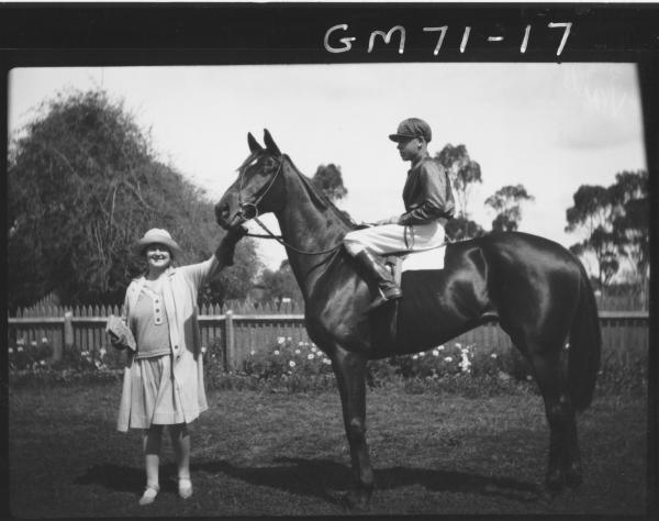 Woman holding race horse with jockey. H.E.Vail (commissioned?) 'Runabout' - Winner Kalgoorlie Cup, 1928 and 1929