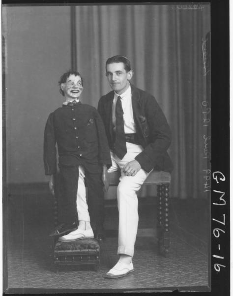 PORTRAIT OF MAN AND VENTRILOQUIST DOLL, F/L, PAUL