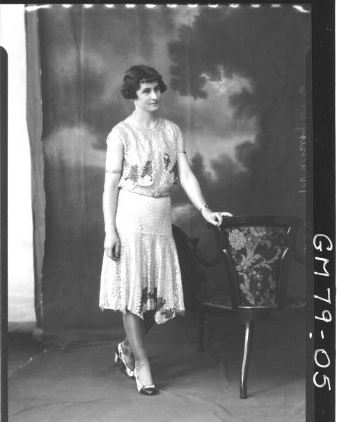 PORTRAIT OF WOMAN, F/L, PAGE