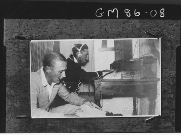 COPY OF TWO MEN OPERATING RADIO