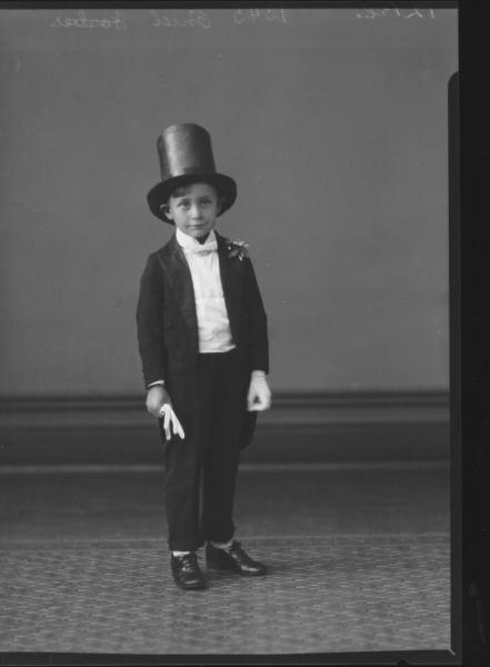 PORTRAIT OF BOY WEARING FANCY DRESS COSTUME, O'NIEL
