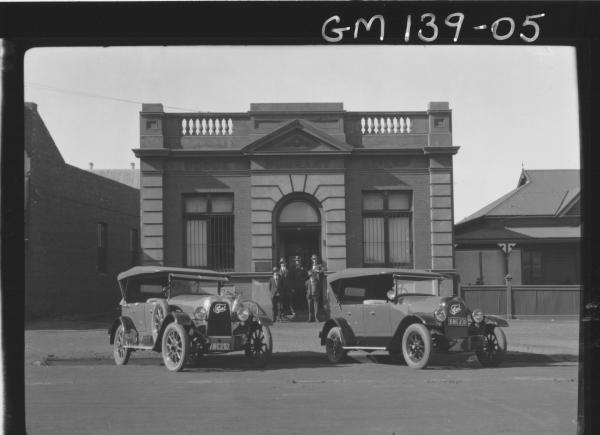 Men and cars outside Goode Durrant Office