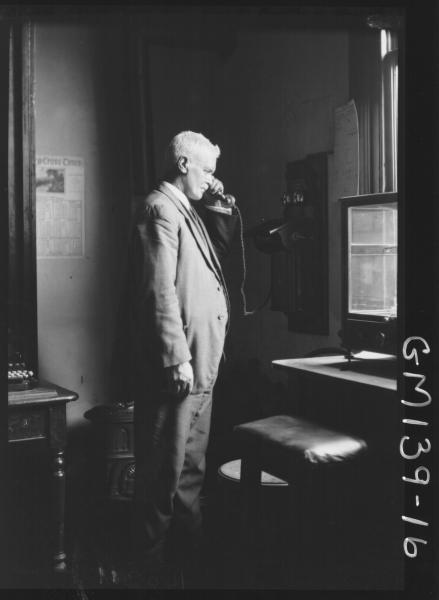 Man in office telephoning