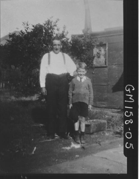 Portrait of man and child in garden 'Batten'