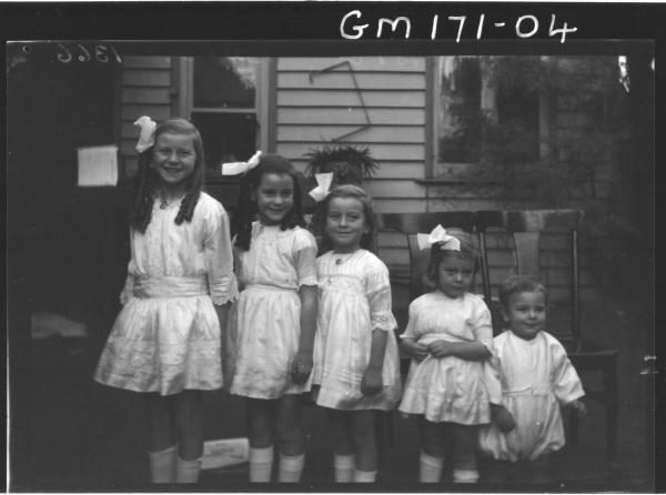 Five children outside house, 'Barker'