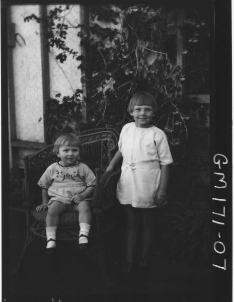 Outside picture of two children 'Crump'