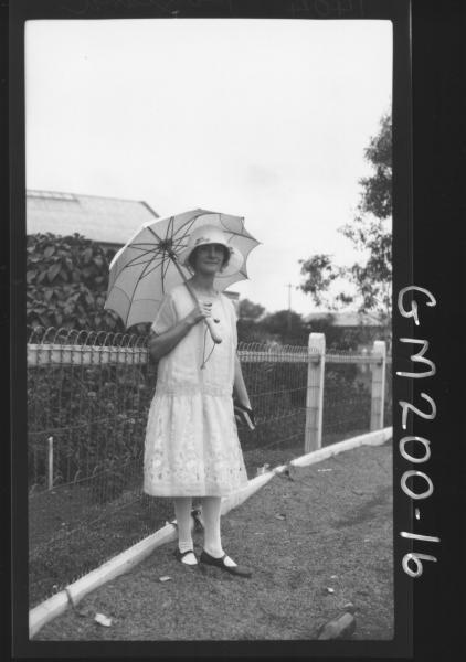 Woman outside house 'Boyland'
