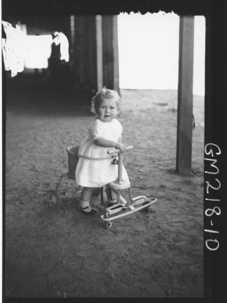 Portrait of child in shed 'Meade'