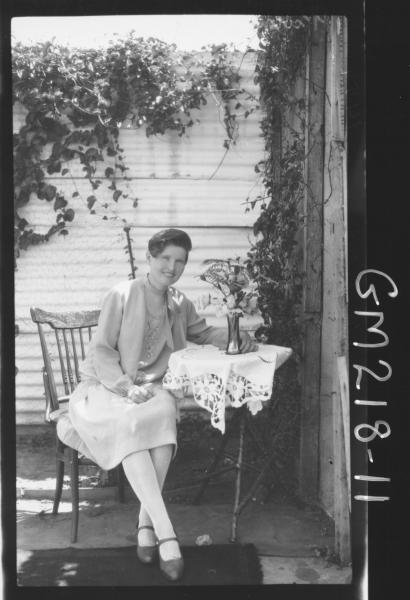 Portrait of woman on verandah 'Hosbach'