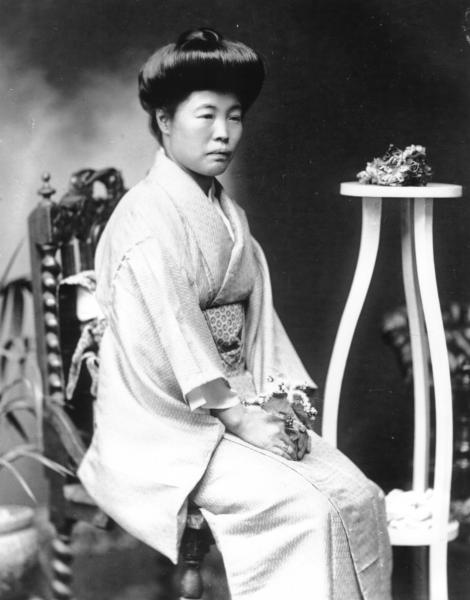 Portrait of Japanese woman seated, wearing kimono