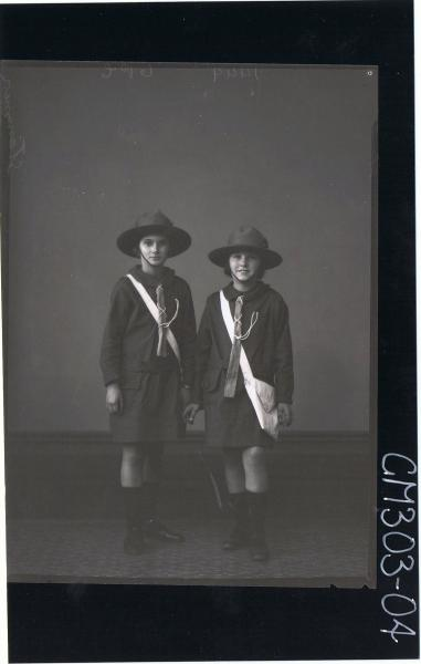 F/L Portrait of two girls standing, wearing girl guide uniforms; 'Stammer'