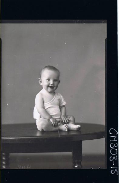 F/L Portrait of baby seated on table wearing vest; 'Sheehan'