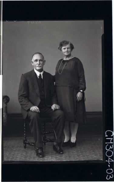 F/L Portrait of man seated, wearing three piece suit, woman standing wearing knee length dress; 'Scott'